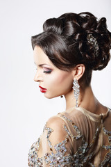 Classy Brown Hair Lady with Jewelry and Festive Hairstyle