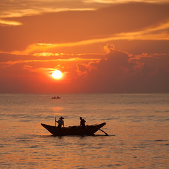 Scenic view at Indian ocean at Sri Lanka with fishman in boat