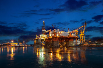 Oil Rig at night in shipyard.
