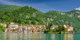 Frontal view of colorful town Varenna seen from Lake Como