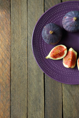 Fresh figs on the purple plate