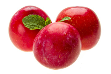 Bright ripe plum with mint