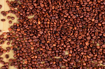 coffee beans on a brown-green wooden background