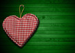 Cloth Heart on Green Wood Background