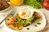 Poached egg on toast with vegetables