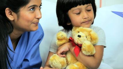 Little Ethnic Child Patient Comforted Nursing Staff