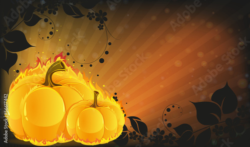 Burning pumpkins on radiant background