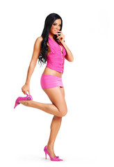 Young attractive woman in pink on white background