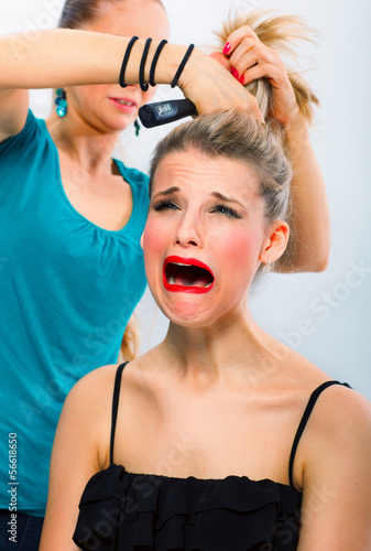 Frightened woman unsatisfied with hairdresser