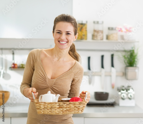 Smiling young housewife with breakfast tray