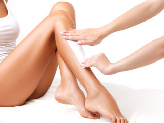 Well-groomed female legs after depilation isolated on white back