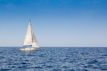 beautiful sailboat with a white sail
