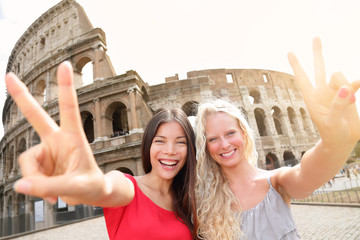 Travel tourist girl friends by Colosseum, Rome