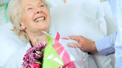 Senior Female Patient Bouquet Flowers Visiting Son