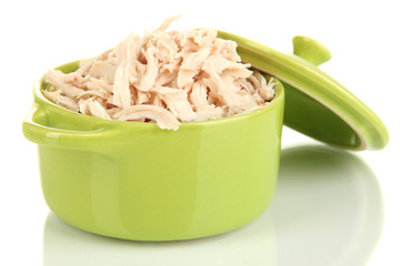 Shredded boiled chicken in green pan isolated on white