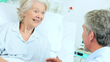 Older Patient Enjoying Hospital Visit Male Relative