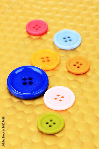 Color buttons on bright background, close-up