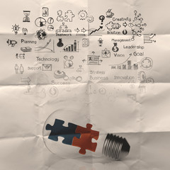 Light bulb and puzzle piece as ideas