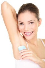 Deodorant - woman applying deodorant in armpit