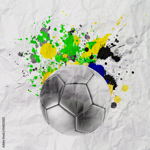 Soccer ball with Brazilian flag splashing colors