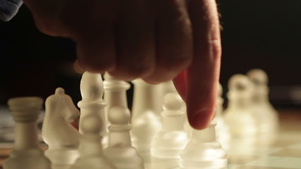 moving chess pieces on the chessboard: glass, finger, hand, move