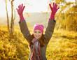 Young woman enjoying fall season. Autumn outdoor portrait