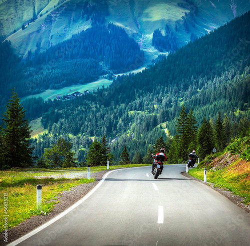 Group of bikers in mountains