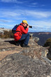 Photographer taking photos of mountain landscape