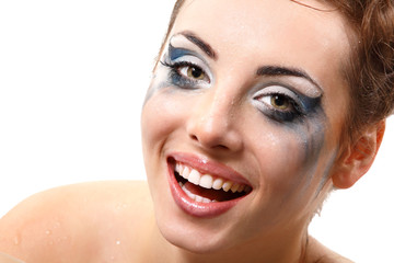 hysterics crying and smiling woman with wet makeup over white