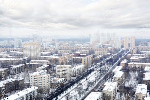 Many houses in residential district at winter cloudy day