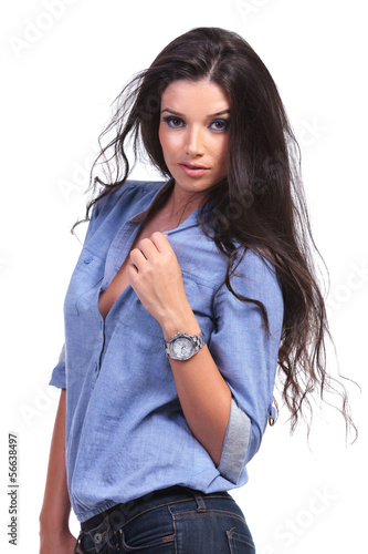 casual woman with hand on shirt