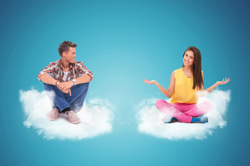 two young people sitting on clouds welcoming