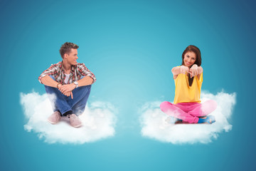 two young people sitting on clouds