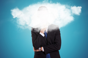 business man with a cloud over his face