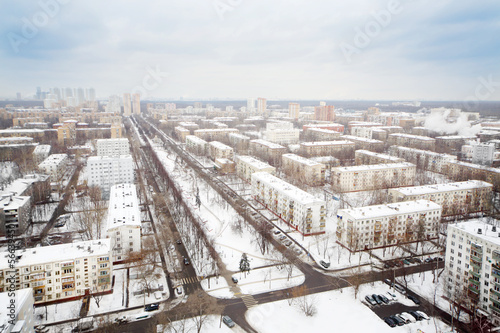 Streets and residential buildings in district at winter