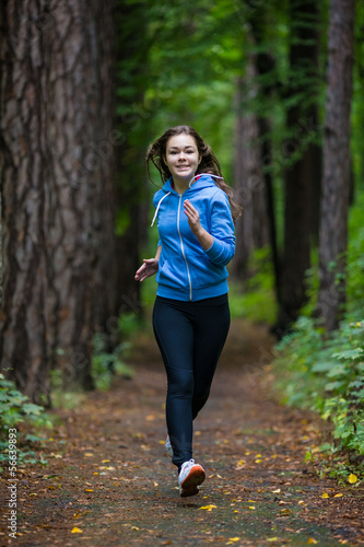 Girl running in park