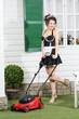 Beautiful young housemaid poses with lawn mower
