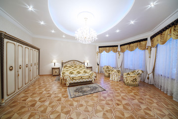 Luxurious bedroom with beautiful double bed, wardrobe