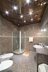Bathroom with shower cabin, toilet and bidet