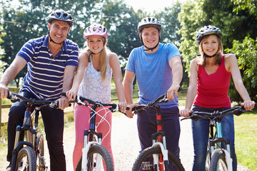 Family With Teenage Children On Cycle Ride In Countryside