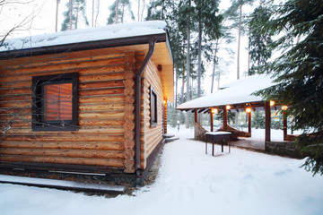Wooden bath, barbecue for meat and canopy among pines and firs