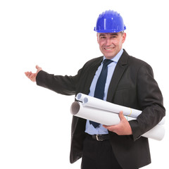 portrait of a senior engineer presenting something and smiling