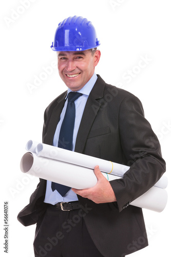 senior engineer holding some papers