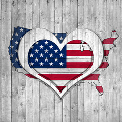 American flag, map, wooden background with heart