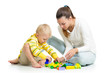 kid boy and mother play together with construction set toy