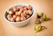 Hazelnuts with shell on the wooden table