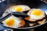 fried eggs in bred a delicious recipe of cooking fried eggs  poster