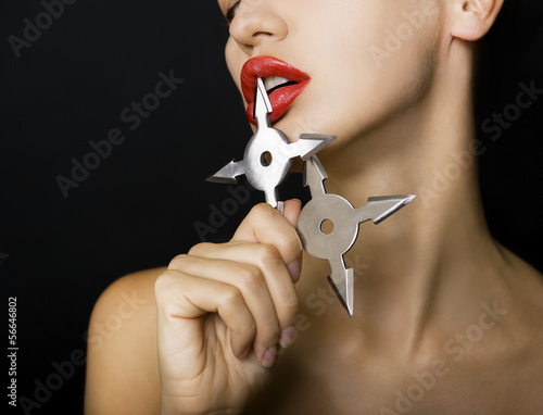 beautiful girl holding a shuriken