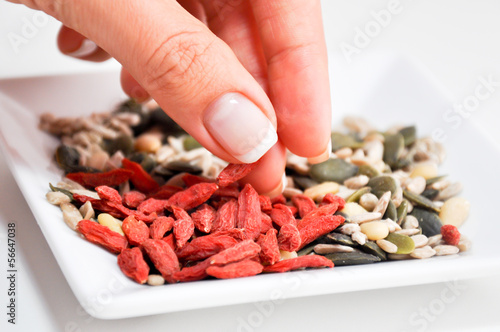 eating healthy goji and various seeds