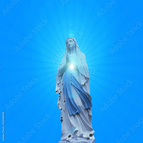 madonna  statue with blue sky background Poster